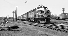 Erie EMD F3 late production diesel electric locomotive ABBA lash-up led by F3A # 710, along with its manifest freight train is seen while passing through the New Haven Railroad Yard at Maybrook, New York, ca 1950 (alcomike43) Tags: erierailroad railroads trains newhavenrailroad freighttrains manifestfreighttrains boxcars freightcars refrigeratorcars outsidebracedgondola tracks rails ties rightofway mainline roadbed ballast jointedsectionrail spikes tieplates anglebars turnout switch employee people maybrookyard railroadfacility buildings house locomotives engines deisels emd f3a f3b 710 dieselengine diesellocomotive dieselelectriclocomotive photo photograph negative bw blackandwhite old historic vintage classic