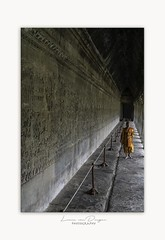 Monk in the Angkor Wat temple , Cambodia (Lucie van Dongen) Tags: perspective pointdefuite light basrelief fresques gallery khmer khmertemple angkorwat asia monk cambodge cambodia