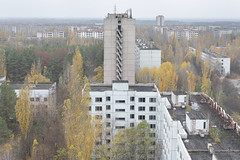 Pripyat Rooftop (Jonnie Lynn Lace) Tags: abandoned ukraine chernobyl pripyat при́пять чорнобиль light day classic history time nuclear disaster green white yellow ruins ruinas nikkor nikon d750 50mm digital flickr travel trip europe european exploration explore urbex texture textures derelict decay detail leaves fall autumn automne rooftop city view aerial sign letters architecture art ferriswheel building buildings old historic jonnielace tree cityscape