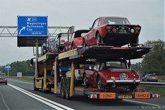 Trailer with a bunch of classics (NielsdeWit) Tags: nielsdewit car vehicle trailer a12 driving highway bmw 02 series austinhealey 3000 dh7018 lancia fulvia 13 rallye rally ralley cp triumph tr6 mg b mgb roadster mga a dm5518 4thk41
