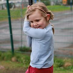 Amanda playing in the monkey swing (erlingurt) Tags: canon eos rp kids swing