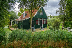 Zaanse Schans Cottage (Brett of Binnshire) Tags: cottage bridge plants water stream zaanseschans historicalsite zaandam museum house trees architecture netherlands window footbridge locationrecorded door potager river northholland