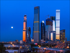 Russia. Moscow. Full moon and Moscow-City. (Yuri Degtyarev) Tags: russia moscow full moon moscowcity skyscrapers evening bluehour полнолуние город москва сити ммдц москвасити луна высотки небоскребы