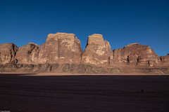 The Kingdome of Sandstone (Vagabundina) Tags: jordan middleeast asia landscape scenery mountain hills sand sandstone desert cliffs sky blue yellow atmosphere moment wideangle horizon magnitude magnificent