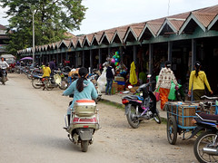 Down near Hsipaw's main market (Claire Backhouse) Tags: market shopping local domestic life living myanmar burma burmese people women riding motorbike motorcycle moto rider rural
