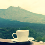 White cup of hot coffee on nature background. Bali island. Volcano Batur. thumbnail