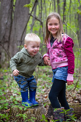 Logan_Year_Three_0003 (Andrew d'Entremont) Tags: little boy toddler girl tween green walking log forest woods trees brother sister blond blonde branch branches leaves outside outdoors nature walk stump