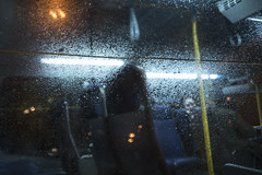 Bus / Autobus (MarkoRadinkovic) Tags: passenger vancouver radinkovic canon 5d contax zeiss distagon 28mm bridgeport station droplets rain wet reflections neon light seats bus m42 richmond canada drops texture glass window night commute