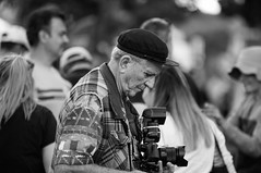 Greek Festival - Paniyiri 2019 (StoryInABox) Tags: 500px man flat cap camera black white old age festival paniyiri brisbane greek 2019 photographer photography nikon d5000