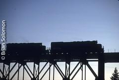 SP_Tunnel_Motor_on_trestle_at_Redding_Calif_Aug31_1991_KM©BrianSolomon592507 (briansolomon.author) Tags: railroad train tunnelmotor redding southernpacific bridge viaduct california sunset