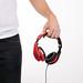 Man holding red headphones