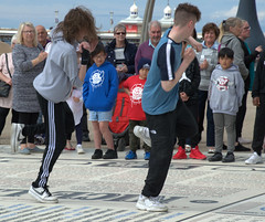 Dancing on the Comedy Carpet at Blackpool - (Tony Worrall) Tags: blackpool resort place england english north northwest visit county town area northern location lancs lancashire uk fylde fyldecoast coastal tour country welovethenorth urban candid people person capture outside outdoors caught photo shoot shot picture captured picturesinthestreet photosofthestreet dance dancing music kids young comedycarpet fun youngsters letsdance nw update attraction open stream item greatbritain britain british gb buy stock sell sale ilobsterit instragram