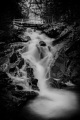 Dunlop Falls (SNAPShots by Patrick J. Whitfield) Tags: bnw blackwhite blackandwhite monochrome waterfalls nature outside landscapes water light shadows highlights details lines patterns textures dof gatineaupark rocks reflections spring sun life longexposure mono day tree white