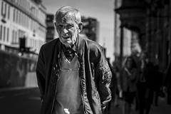 Furrowed Brow (Leanne Boulton) Tags: urban street candid portrait portraiture streetphotography candidstreetphotography candidportrait streetportrait eyecontact candideyecontact streetlife old elderly man male face eyes expression emotion mood feeling tone texture detail depthoffield bokeh naturallight outdoor sunlight light shade shadow contrast city scene human life living humanity society culture lifestyle people canon canon5dmkiii 70mm ef2470mmf28liiusm black white blackwhite bw mono blackandwhite monochrome glasgow scotland uk