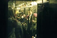 pink fur (gguillaumee) Tags: film analog grain street streetphotography nyc newyork pink fur girl lost candid fujisuperia metro subway train window saturation urban city leica leicam7 35mm rangefinder