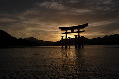 Itsukushima Floating Torii Sunset - Miyajima Island (Japan) (Andrea Moscato) Tags: andreamoscato giappone japan asia japanese 日本 nihon nippon asian light luce shadow ombre prefecture attraction site national nature natura natural naturale landscape paesaggio sky cielo view vivid vista scenic history historic ancient treasure wood art architecture monument brilliant water silhouette sea seascape seashore beach torii gate bay hiroshima unesco world heritage island seto inland setonaikai reflection tide sunset dusk orange red yellow evening sun dark wave clouds nuvole mountain black gold golden