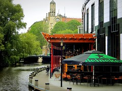 Amsterdam Casino (Clare-White) Tags: canal amsterdam city water cafes seats americianhotel buildings architecture trees walkway person one bridge dutch
