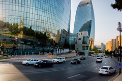 BAKU, AZERBAIJAN - JULY 24: Street in downtown of the capital of Azerbaijan, on July 24, 2014, with great modern architecture. (liseykina) Tags: baku azerbaijan tower city flame architecture view landmark towers travel building famous destination center capital downtown cityscape mosquer square park flametowers modern street road car traffic bakuazerbaijantowercityflamearchitectureviewlandmarktowerstravelbuildingfamousdestinationcentercapitaldowntowncityscapemosquersquareparkflametowersmodernarchitecturefamousstreetroadcartraffic original big stock