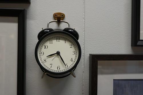 round clock amongst squares