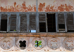 Windows of an old old french colonial building, Sud-Comoé, Grand-Bassam, Ivory Coast (Eric Lafforgue) Tags: abandoned africa ancient architecture broken buildingexterior builtstructure city colonialbuilding colonialstyle colourimage côtedivoire day decline downtowndistrict facade french ghosttown grandbassam history horizontal house ivorycoast ivory2859 nopeople old oldruin oldfashioned outdoors photography régiondeslagunes ruined rundown rustic sudcomoé tourism town travel traveldestinations tree unescoworldheritagesite weathered westafrica windows