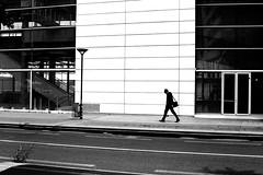 Under lines (pascalcolin1) Tags: paris13 homme man lignes lines mur wall ombres shadows sac bag lamppost lampadaire photoderue streetview urbanarte noiretblanc blackandwhite photopascalcolin canon50mm canon 50mm soleil sun