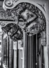 Door keepers (David Feuerhelm) Tags: mono monochrome bw blackandwhite noiretblanc schwarzundweiss blancoynegro bokeh sculpture carving pan street doorway nikkor oxford nikon d750 2470mmf28