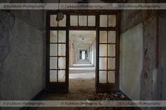 Bleeding Rust (ficktionphotography) Tags: abandoned abandonedbuilding abandonedasylum hallway rust discarded urbex urbanexploration peelingpaint