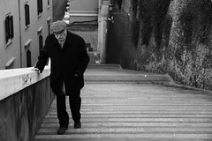 Step by step... (Michael Kalognomos) Tags: oldman blackwhite bw monochrome ef24105mmf4l canoneos5dmarkiii steps rome italy bokeh dof depthoffield streetphotography streetlife stairway