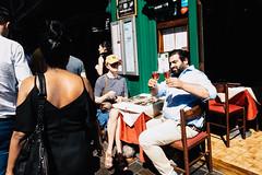 Checking drinks on Berwick Street (Bosscat2) Tags: berwickstreetsoho londonstreets soholondon wineglass alfrescodrinking ricoh ricohgrd3