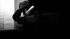 Guitar is not a thing it's extension of myself (Michael Kalognomos) Tags: canon canoneos5dmarkiii canonfd35mmf28 blackwhite bw monochrome guitar light bokeh dof depthoffield strings hands fingers reflection man