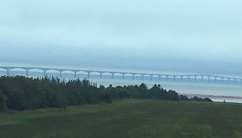 Seen in a distant fog, the Confederation Bridge spans the strait between New Brunswick and Prince Edward Island.