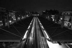 Arriving or Departing? (Michael Kalognomos) Tags: train canonfd35mmf28 canoneos5dmarkiii photography cinematography blackandwhite wideangle bw canon multipleexposure lighttrails longexposure metrostation athens greece night nightlights urbanlandscape architecture