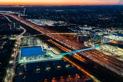 Pickering GO Bridge 051 (Michael Muraz Photography) Tags: 2019 canada northamerica on ontario pickering pickeringgo pickeringgobridge pickeringgopedestrianbridge toronto world aerial aerialphotography architecture bridge commercial dusk lighting night pedestrianbridge twilight