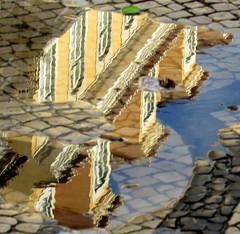 em baixo e em cima (Américo Meira) Tags: portugal lisboa baixa janela reflexo poça