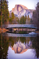 Mother Nature (Thomas Hawk) Tags: america california julia juliapeterson kate katepeterson nationalpark usa unitedstates unitedstatesofamerica yosemite yosemitevalley bridge mrsth reflection river spouse water wife fav10 fav25 fav50 fav100