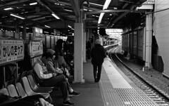 Suburban train platform (odeleapple) Tags: leica m3 carl zeiss planar 50mm kodak400tx film monochrome analog bw train platform passenger