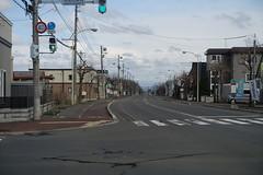 To the East (sjrankin) Tags: 15april2019 edited road view yuni intersection trafficsignal crosswalk clouds hills kitahiroshima hokkaido japan
