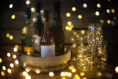 Wine and Bokeh (flashfix) Tags: april142019 2019inphotos flashfix flashfixphotography ottawa ontario canada nikond7100 40mm wine bottles glasses flutes bokeh product stilllife