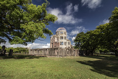Atomic Bomb Dome Memorial Building - Hiroshima (Japan) (Andrea Moscato) Tags: andreamoscato giappone japan asia japanese 日本 nihon nippon asian light luce green shadow ombre prefecture attraction ombra site national nature natura natural naturale landscape paesaggio day sun sunshine white sky cielo view vivid vista scenic blue parco park trees history historic ancient wood art giardino branch building architecture monument tree edificio brilliant unesco world heritage sites peace memorial war sign structure heiwa kinenhi hall genbaku ruin afternoon memory field grass