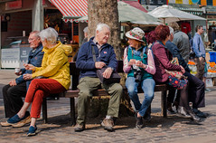 On the bench (+Pattycake+) Tags: streetphotography colours pancakelens city onthebench canon orange hat blue purple eos70d norwich marketplace colourful bench ©patriciawilden2019 yellow 40mmprimelens rides