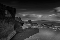 "old power vs new power - crumbling WWII defences on the beach, magnificent wind turbines at sea. Aberdeen Beach, Aberdeen, Scotland (grumpybaldprof) Tags: bw blackwhite ""blackwhite"" ""blackandwhite"" noireetblanc monochrome ""fineart"" ethereal striking artistic interpretation impressionist stylistic style contrast shadow bright dark black white illuminated mood moody atmosphere atmospheric calm peaceful tranquil restful ""longexposure"" ""neutraldensity"" nd canon 7d ""canon7d"" sigma 1020 1020mm f456 ""sigma1020mmf456dchsm"" ""wideangle"" ultrawide aberdeen aberdeenshire scotland uk ""siorrachdobardheathain"" ""aberdeencity"" ""granitecity"" ""oldaberdeen"" grampian ""beautifulcity"" ""northeastscotland"" ""aberdeenbaywindfarm"" ""europeanoffshorewinddeploymentcentre"" eowdc offshore windfarm windturbines ""offshorewindfarm"" turbines blackdog ""bridgeofdon"""