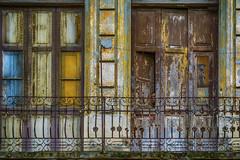 whos there? (Andrew Brammall Photography) Tags: hiding havana cuba habana decay street people building railings
