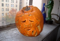 Pruneface from Dick Tracy 2008 Halloween Pumpkin 9915 (Brechtbug) Tags: second pruneface villain jack o lantern carved 2008 its various stages decay nyc window sill new york city holiday orange rotting gourd newspaper news paper cartoon comics sunday funnies strip prune face african art bird mexican skeleton