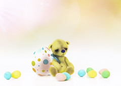 button does not like eggs (rockinmonique) Tags: button tinybear easter eggs whimsical pastels pretty macro bokeh yellow green pink moniquewphotography c canont6s tamron tamron45mm copyright2019moniquewphotography