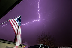 Behind the Flag (Uncharted Sights) Tags: april 17th 2019 lightning thunder storm thunderstorm severe weather chase flash sky skies night long exposure canon 80d tamron 1750 commerce city denver colorado atmosphere power adventure nature