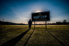 Making a statement...... (Dafydd Penguin) Tags: keep off sign message silhouette grass private property newcastle close house person big sun shadow words northumberland hadrians wall trail national river tyne playing field soccer rugby cricket leica m10 21mm super elmar f34 asph