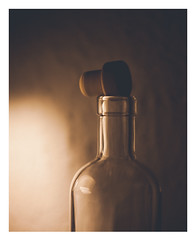 Breathing Spirits (Thomas Listl) Tags: thomaslistl color mood atmosphere stilllife bottle empty glass light cork whisky finespirits singlemalt dark wall 50mm