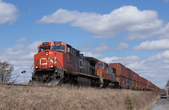 Straight Outta Chicago - Enfield, NS (CWentzell Photography) Tags: cn canadiannational railroad railway rails freight train chicago intermodal containers container ge c449w motivepower locomotive locomotives santa fe warbonnet emd prlx novascotia halifax bedford sub subdivision bluesky sunny april 2019 canon photography adobe adobelightroom