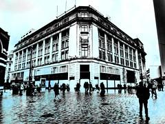 Wet in the city (ronramstew) Tags: liverpool merseyside people building rain owenowen tesco store shop 2019 2010s