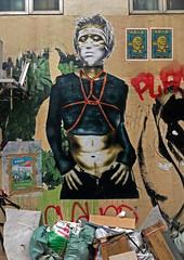 Trashy Street Art (cowyeow) Tags: woman girl sticker random china street chinese asia asian 香港 hongkong sheungwan city urban composition graffiti wall streetart odd weird funnyhongkong painting art trash